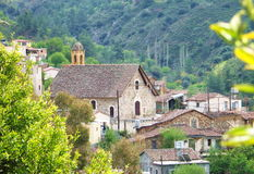 Village Church. The church and houses in Gourri village Royalty Free Stock Photography