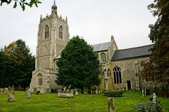 Village Church. All Saints Village Church surrounded by the church cemetery Royalty Free Stock Photo