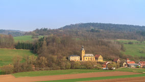 Village Church. Christian Church in Northern Bavaria in early spring 2013 in the countryside, shot in April Stock Image