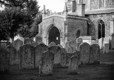 Village church and gravestones. Traditional ancient English village church with gravestones Royalty Free Stock Photo