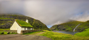 Village church and a lake in Saksun, Faroe Islands, Denmark Stock Photo