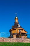 Village church. Village russian orthodox church with glided cupola on deep blue sky background Stock Images