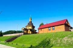 Village church. Village russian orthodox church with glided cupola on deep blue sky background Royalty Free Stock Photo