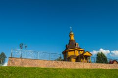 Village church. Village russian orthodox church with glided cupola on deep blue sky background Stock Photos