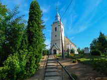 Village church in summer daylight stock images