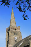 Village Church tower with spire and clock. Stock Images