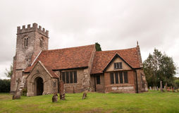 Village Church under grey skies Royalty Free Stock Photo