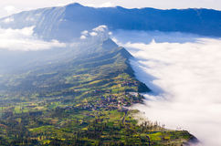 Village and Cliff at Bromo Volcano, Indonesia royalty free stock images