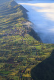 Village and Cliff at Bromo Volcano Mountain Stock Photography