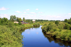 Village on coast river Royalty Free Stock Images
