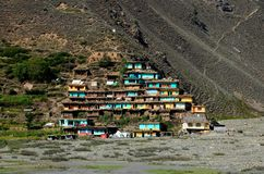 Village with colorful houses on mountainside Kaghan Valley Pakistan. Kaghan Valley, Pakistan - September 26, 2016: A small Pakistani village built on a Royalty Free Stock Photo