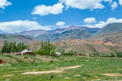 Village and colorful mountains of Tien Shan Stock Photos