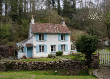Village Cottage. Quaint Cottage set in a wooded valley in Rural England Stock Photography