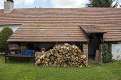 Village cottage with cut wood. And towel Royalty Free Stock Image