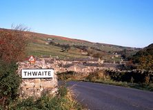 Village and countryside, Thwaite, Yorkshire Dales. View of the village and surrounding countryside, Thwaite, Yorkshire Dales, North Yorkshire, England, UK Royalty Free Stock Image