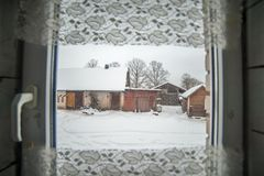 Homestead view from indoors in winter stock image