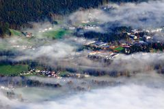 Village Covered by Fog Stock Image