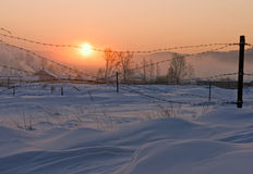 Sunrise in winter village Stock Photo