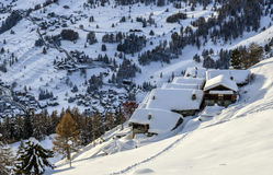 Village of Crest, Ayas valley (North Italy). View of the village of Crest in winter with snow, city of Champoluc in background, Ayas valley (North Italy Stock Images