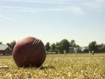 Village cricket. A cricket ball shot against a village cricket match in England Royalty Free Stock Photography