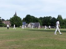 Village cricket game on Chorleywood Common royalty free stock images