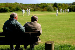 Village cricket match spectators. A couple of old chaps watching village cricket match Royalty Free Stock Photography
