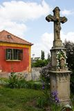 Village crucifix. Old village house and a in Balaton-Uplands, Hungary, Central Europe Stock Image