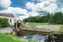 Village dam. Village hidroelectric dam with forest and river Stock Photography