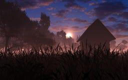 Village dans le coucher du soleil Photographie stock