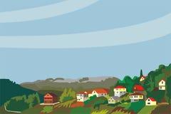 Village dans les montagnes et la forêt Photographie stock libre de droits