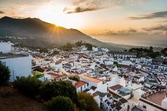 Village de blanc de coucher du soleil Images stock