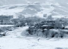 Village de montagne d'hiver Photographie stock