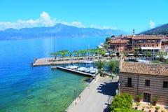 Village of Torri Del Benaco on the garde& x27;s lake beautiful blue water and sky