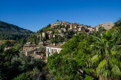 Houses of Deia. View of the central hill in Deia, Mallorca, Spain. Village Deia in tramuntana mountains Mallorca Royalty Free Stock Images