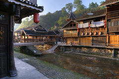 Village of Dong ethnic minority in light of sunset, China. Royalty Free Stock Image