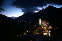 Village at dusk. A village at dusk in the Alps stock images