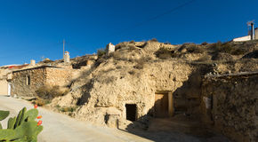 Village with dwellings houses built  into rock Stock Photo