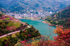 Village at edge of Yangtze river. The village at the edge of Yangtze river with full red leaf , China Royalty Free Stock Images
