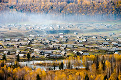 Village embraced by forest Royalty Free Stock Image