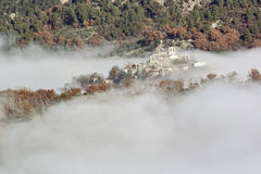 Village emerges from the fog Royalty Free Stock Image
