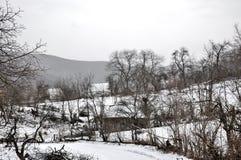 Village en hiver Photographie stock libre de droits