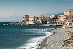 Village and shingle beach of Erbalunga in Corsica. Village of Erbalunga and shingle beach on the east coast of Cap Corse in Corsica royalty free stock images