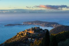 The Village of Eze, the Mediterranean Sea and Saint-Jean-Cap-Ferrat at sunrise. French Riviera, France. The Village of Eze Èze, the Mediterranean Sea and royalty free stock image