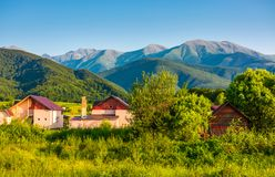 Village in Fagaras mountains of Romania. Lovely rural scenery in evening Stock Photography
