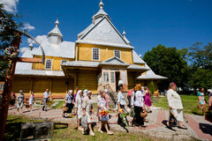 Village families came from the wooden Orthodox church Stock Image