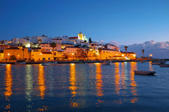 The village Ferragudo in Portugal at sunset. The village Ferragudo in the Algarve Portugal at sunset Stock Image