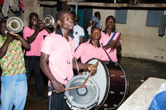 Village festival. Anekro, ivory coast-August 20, 2015: a group of instrumentalists musicians perform at the home of the king of the region Royalty Free Stock Image