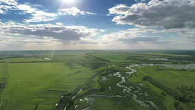 Village and Fields With a Bird`s-eye view in Spring. Aerial shot: Village With a Bird`s-eye view in Spring stock footage