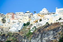 Village of fira. White washed houses of the capital town of santorini - fira - perched on the volcanic cliffs of the island Stock Photos