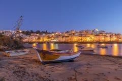 Village of fishermen, Ferragudo yellow lights lanterns. Stock Photo
